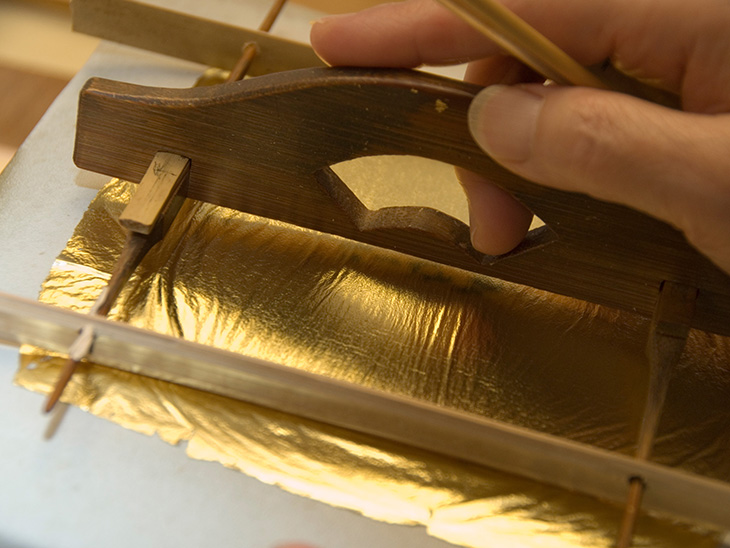 Cutting gold leaf